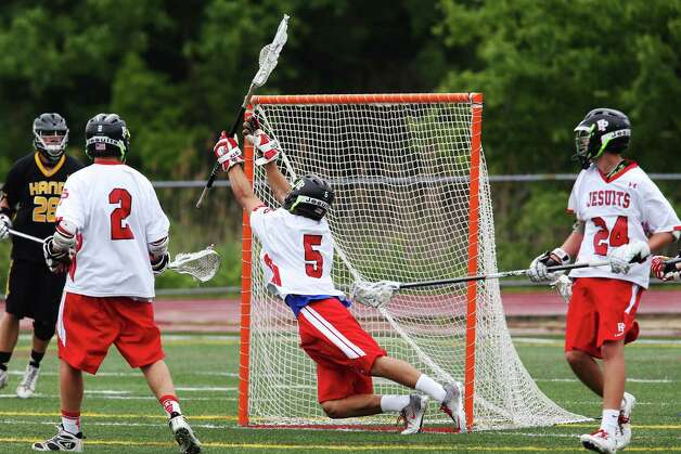 Fairfield Preps goalie Mike Seelye makes a save against the goal  in the SCC championship lacrosse game vs. Daniel Hand High School on Friday May 24, 2012 in Branford, Conn. Prep won the game with a score of 11-1. Photo: Mike Ross / Connecticut Post Freelance