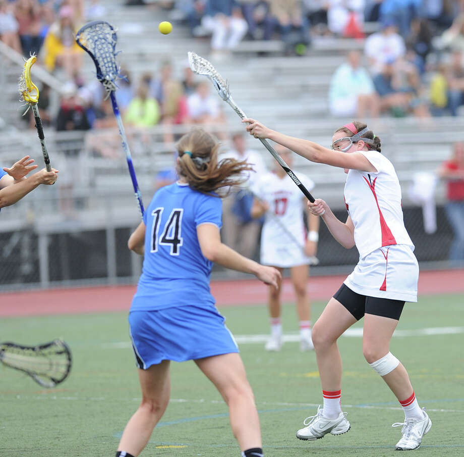 Claire Feeney of Greenwich shoots during the FCIAC girls lacrosse finals between Greenwich High School and Darien High School at Brien McMahon High School in Norwalk, Friday, May 25, 2012. Darien won the championship over Greenwich 17-14. At left is Julia Cobb # 14 of Darien. Photo: Bob Luckey / Greenwich Time