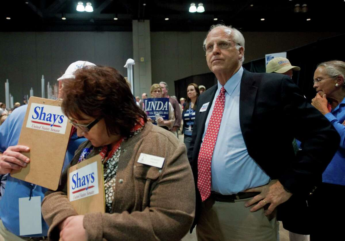 Republican candidate for U.S. Senate Christopher Shays, right, watches as votes are tallied at the Republican state convention in Hartford, Conn., May 18, 2012.