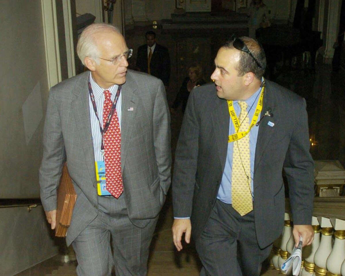 In a 2004 file photo, former U.S. Rep. Christopher Shays, left, makes his way to the ballroom at The Plaza hotel in New York, with his former campaign manager, Michael Sohn.
