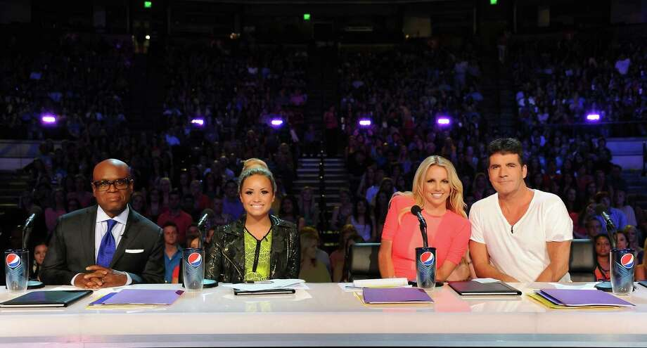 "Judges L.A. Reid, left, and Simon Cowell, are joined by newcomers Demi Lovato, second from left, and Britney Spears for the first auditions for the upcoming ""X Factor"" singing competition, in Austin on Thursday. / FOX"