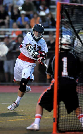 New Canaan's Peter Kraus takes a shot against Ridgefield's goalie Adam Winne during Friday's FCIAC boys lacrosse championship game at Brien McMahon High School in Norwalk on May 25, 2012. Photo: Lindsay Niegelberg / Stamford Advocate
