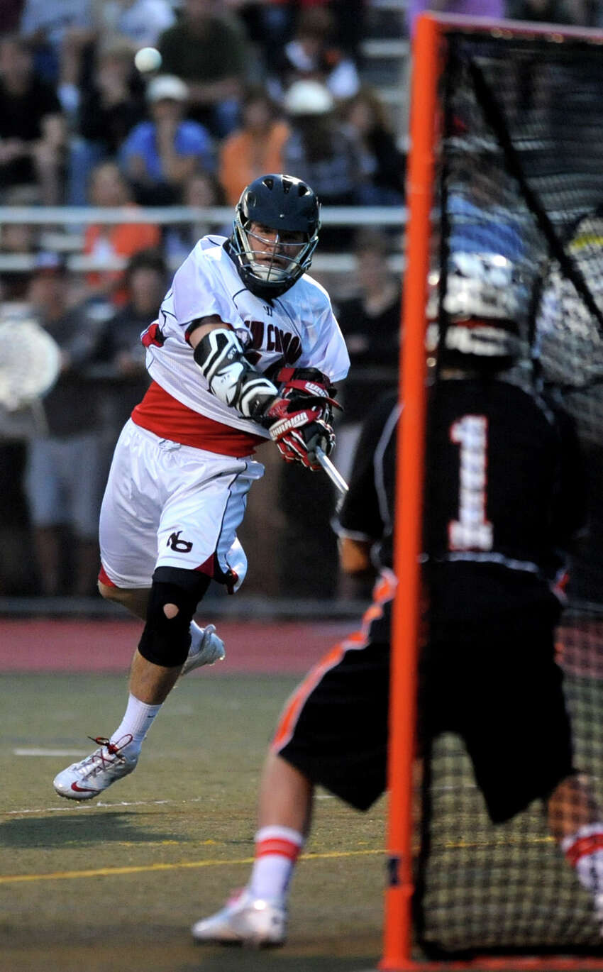 New Canaan's Peter Kraus takes a shot against Ridgefield's goalie Adam Winne during Friday's FCIAC boys lacrosse championship game at Brien McMahon High School in Norwalk on May 25, 2012.
