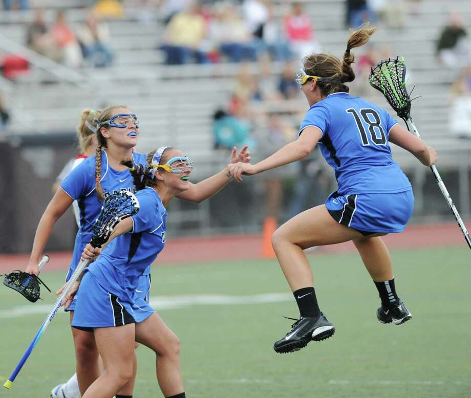 Jena Fritts # 18 of Darien High School celebrates with teammates near the end of the FCIAC girls lacrosse finals between Greenwich High School and Darien High School at Brien McMahon High School in Norwalk, Friday, May 25, 2012. Fritts was named MVP and Darien won the championship over Greenwich 17-14. Photo: Bob Luckey / Greenwich Time