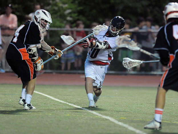 New Canaan's Matthew Blasco scores a goal to break a 7-7 tie against Ridgefield during Friday's FCIAC boys lacrosse championship game at Brien McMahon High School in Norwalk on May 25, 2012. Photo: Lindsay Niegelberg / Stamford Advocate