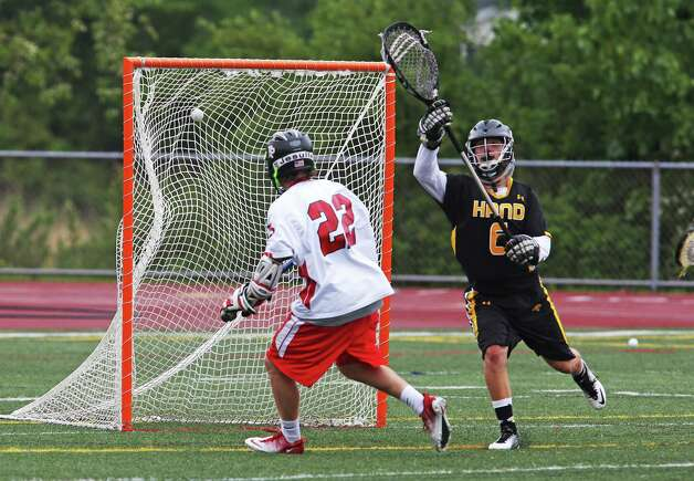 Fairfield Prep's Tim Edmonds scores on Daniel Hand High School's Connor Carroll in the SCC lacrosse championship game on Friday, May 25, 2012. Prep won 11-1. Photo: Mike Ross / Connecticut Post Freelance