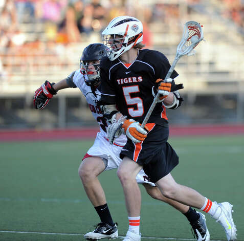 Ridgefield's Calvin Dearth controls the ball during Friday's FCIAC boys lacrosse championship game against New Canaan at Brien McMahon High School in Norwalk on May 25, 2012. Photo: Lindsay Niegelberg / Stamford Advocate