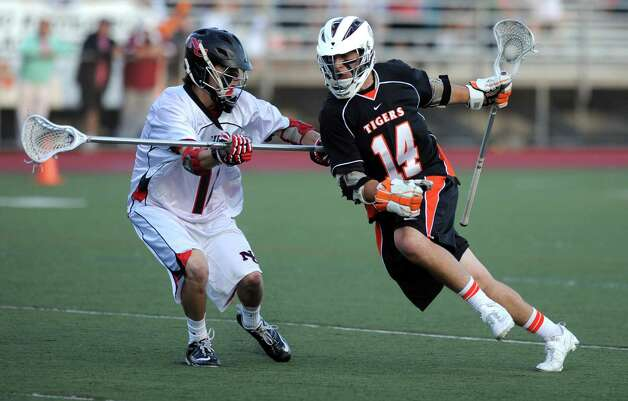 Ridgefield's Eric Scala controls the ball during Friday's FCIAC boys lacrosse championship game against New Canaan at Brien McMahon High School in Norwalk on May 25, 2012. Photo: Lindsay Niegelberg / Stamford Advocate