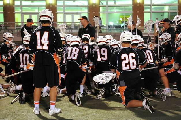 Ridgefield teammates gather after losing to New Canaan during Friday's FCIAC boys lacrosse championship game at Brien McMahon High School in Norwalk on May 25, 2012. Photo: Lindsay Niegelberg / Stamford Advocate