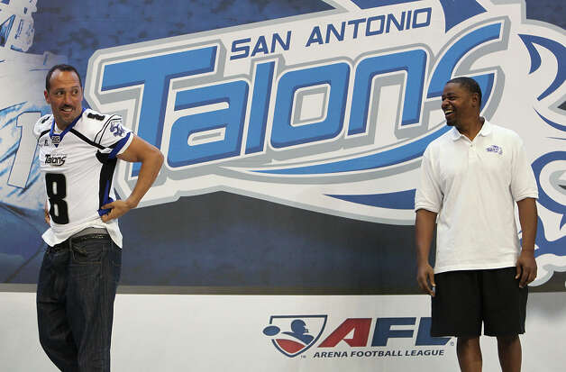 Talons coach Lee Johnson (right) assigns a jersey to quarterback Aaron Garcia (08) as the San Antonio Talons officially introduce team members with a press event at the Alamodome on Tuesday, Mar. 6, 2012. Kin Man Hui/Express-News Photo: Kin Man Hui, San Antonio Express-News / © 2012 San Antonio Express-News