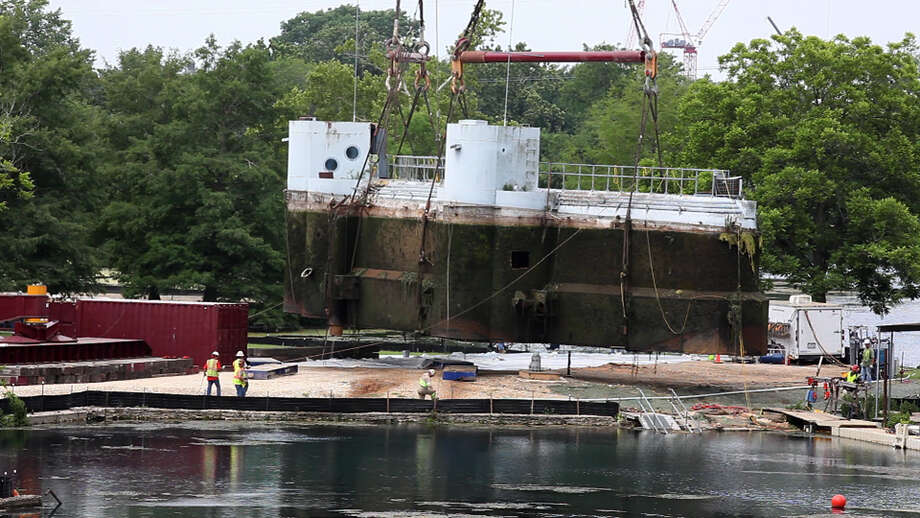 The Aquarena Springs sub is lifted from the water this week in San Marcos as efforts proceed to redevelop the old tourist attraction as an educational center. Photo: Jerry Lara / © San Antonio Express-News
