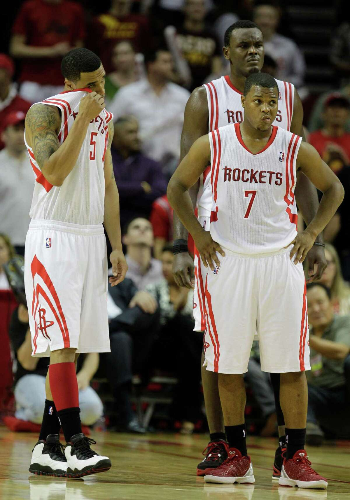 Houston Rockets' Courtney Lee, left, Kyle Lowry, right, and Samuel Dalembert, back right, show their reactions as the team is forced into overtime against New Orleans Hornets' during NBA game at Toyota Center Thursday, Jan. 19, 2012, in Houston. ( Melissa Phillip / Houston Chronicle )