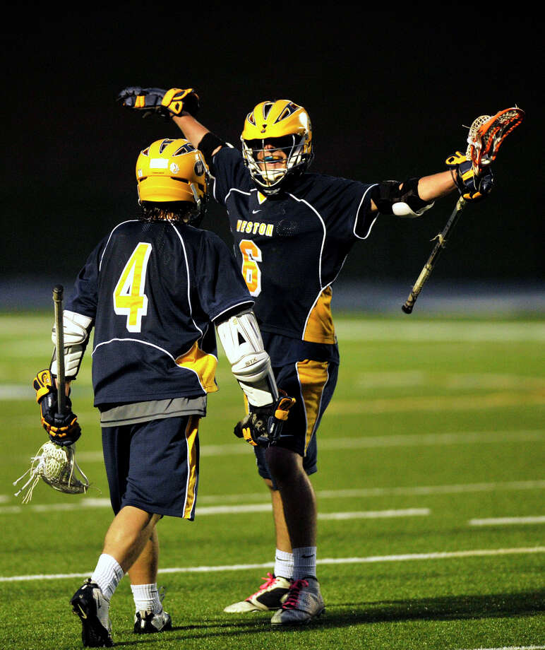 Weston's Sean Fumai, left, and Jack Scheufele celebrate Fumai's goal during their Division I SWC championship game against Joel Barlow at Newtown High School on Friday, May 25, 2012. Weston won 8-6. Photo: Jason Rearick / The News-Times