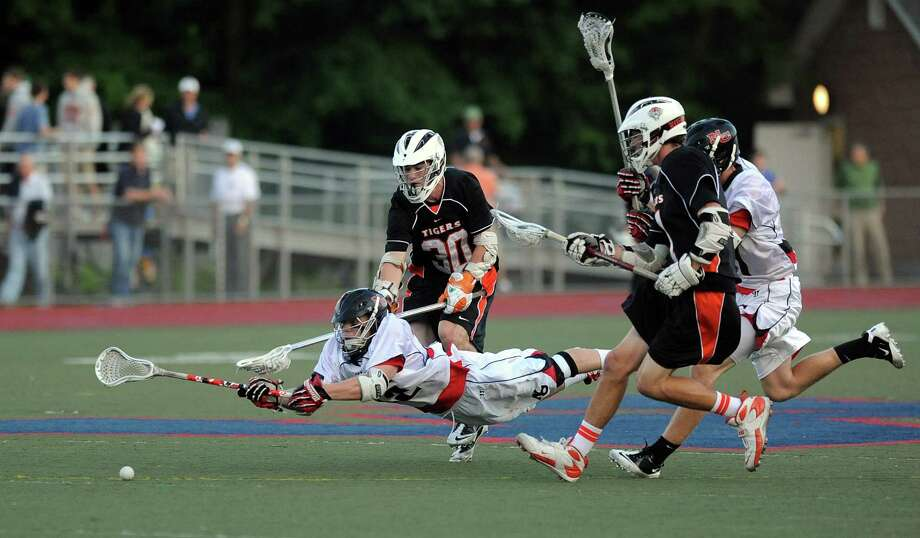 New Canaan's Robert Distler dives for the ball during Friday's FCIAC boys lacrosse championship game at Brien McMahon High School in Norwalk on May 25, 2012. Photo: Lindsay Niegelberg / Stamford Advocate