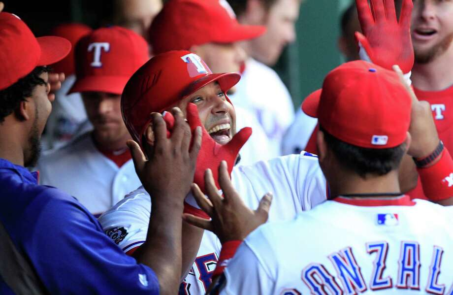 Texas Rangers Yorvit Torrealba celebrates in the dugout with teammates after hitting a solo home run during the third inning of a baseball game against the Toronto Blue Jays Friday, May 25, 2012, in Arlington, Texas. Photo: AP