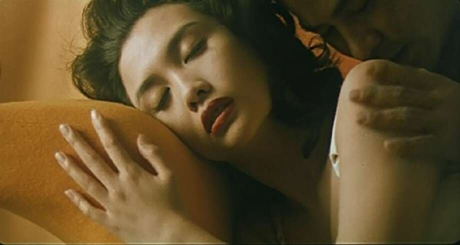 "Chingmy Yau (with Simon Yam) in ""Naked Killer."""