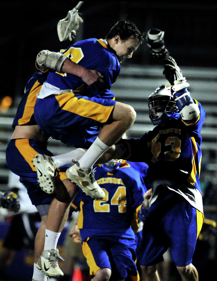 Queensbury's goalie Benjamin Coughlan (26), center, leaps into the arms of his teammates when they win the Section II Class B boys' lacrosse championship over Burnt Hills on Friday, May 25, 2012, at Amsterdam High in Amsterdam, N.Y. (Cindy Schultz / Times Union) Photo: Cindy Schultz / 00017779A