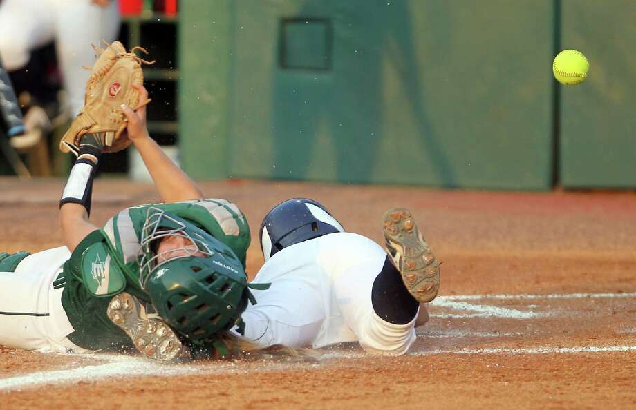 The Woodlands catcher Kayla Prater isn't able to hold on to the ball as Klein Collins' Angelica Gonzales slides safely home during a seven-run first inning in Friday night's Class 5A Region II final. Photo: Nick De La Torre / © 2012  Houston Chronicle