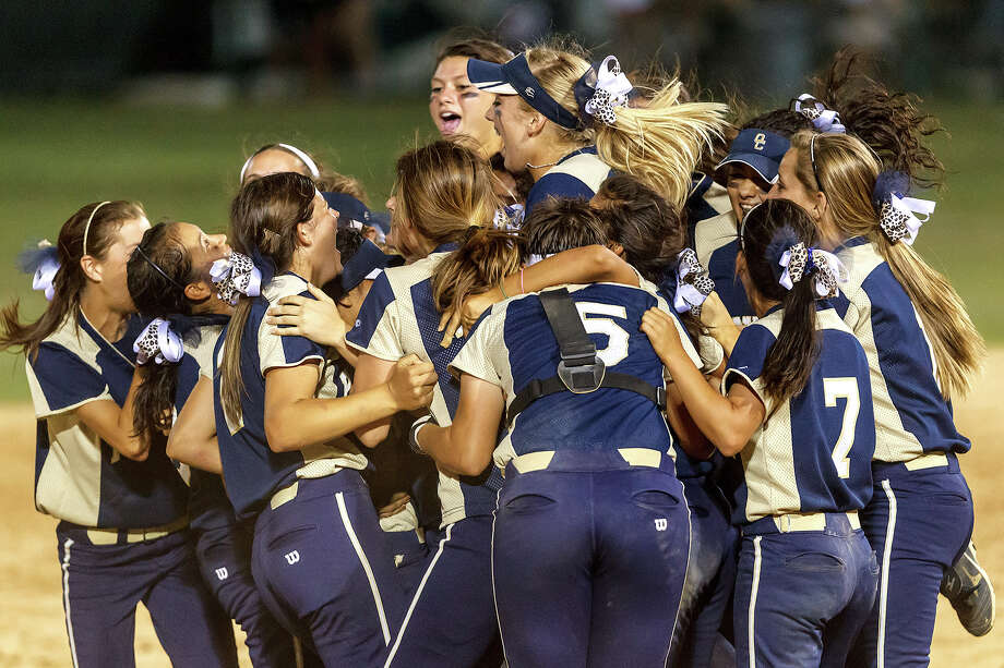 The O'Connor Lady Panthers celebrate following their 5A regional final game with Holmes at Northside Softball Field on May 25, 2012.  O'Connor advanced to the state finals with a 9-2 victory over the Lady Huskies.  MARVIN PFEIFFER/ mpfeiffer@express-news.net Photo: Express-News