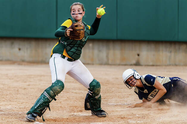 Holmes catcher Hailey Rebar looks towards third base after O'Connor's Sarah Worrell crosses the plate during the fourth inning of their 5A regional final game at Northside Softball Field on May 25, 2012.  O'Connor advanced to the state finals with a 9-2 victory over the Lady Huskies.  MARVIN PFEIFFER/ mpfeiffer@express-news.net Photo: Express-News