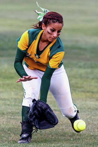 Holmes' Christine Rosas chases down a hit to the outfield during their 5A regional final game with O'Connor at Northside Softball Field on May 25, 2012.  O'Connor advanced to the state finals with a 9-2 victory over the Lady Huskies.  MARVIN PFEIFFER/ mpfeiffer@express-news.net Photo: Express-News