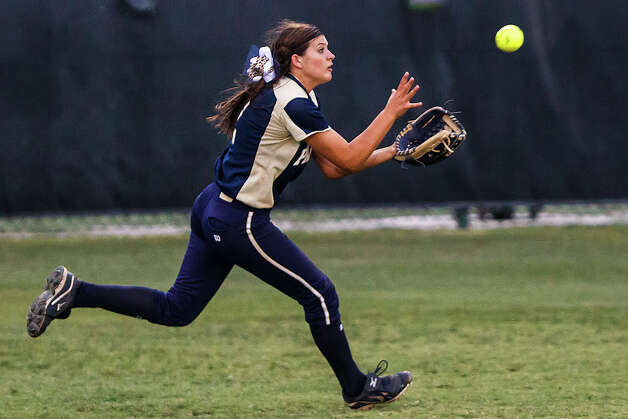 O'Connor center fielder Hannah Fields chases down a fly ball during the fourth inning of their 5A regional final game with Holmes at Northside Softball Field on May 25, 2012.  O'Connor advanced to the state finals with a 9-2 victory over the Lady Huskies.  MARVIN PFEIFFER/ mpfeiffer@express-news.net Photo: MARVIN PFEIFFER, Express-News / Express-News 2012