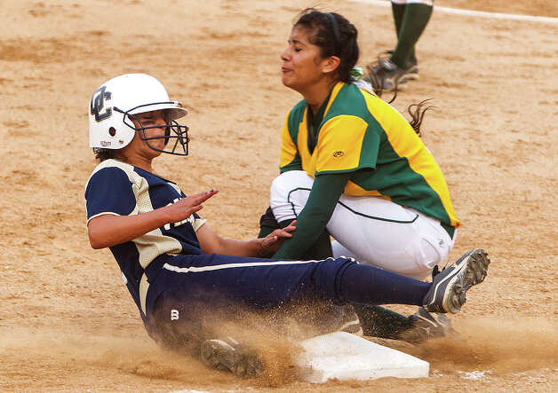 O'Connor's Alex Scheel slides safely into third base under the tag of Holmes' Alyssa Garcia during the third inning of their 5A regional final game at Northside Softball Field on May 25, 2012.  O'Connor advanced to the state finals with a 9-2 victory over the Lady Huskies.  MARVIN PFEIFFER/ mpfeiffer@express-news.net Photo: MARVIN PFEIFFER, Express-News / Express-News 2012