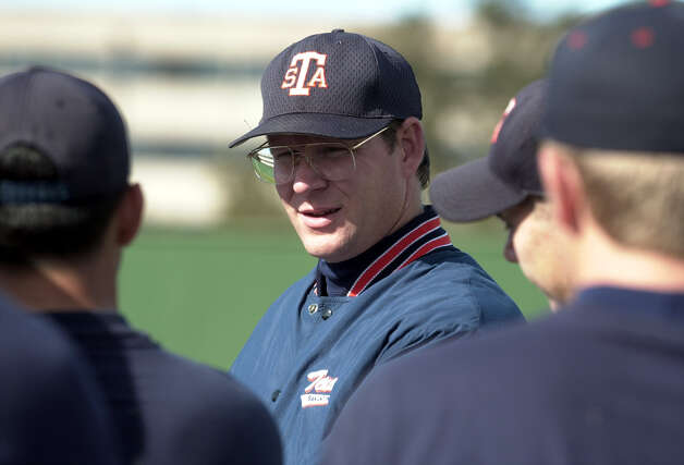 UTSA baseball headcoach Sherman Corbett (left) talks with his pitching squad prior to the start of their season opener on Wednesday, January 31, 2001. Corbett's baseball career has been highlighted with playing at Clemens High School and later played in the major leagues as a pitcher. Kin Man Hui/staff. Photo: Kin Man Hui, Express-News / SAN ANTONIO EXPRESS-NEWS