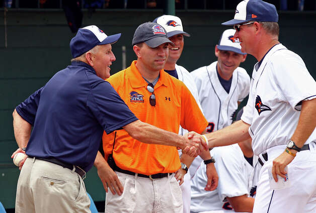 Larry Coker shakes hands with Sherman Corbett as UTSA hosts Texas State University at UTSA baseball stadium on  May 2, 2009.  Tom Reel/Staff Photo: TOM REEL, Express-News / treel@express-news.net