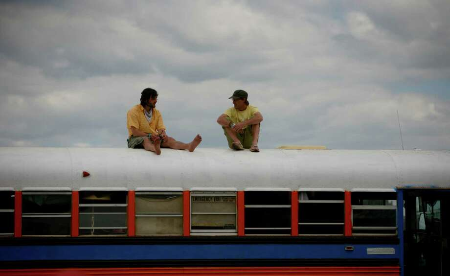 Alex Mistasev and Nathan Etcheverry rest on top of a school bus. Photo: SOFIA JARAMILLO / SEATTPI.COM