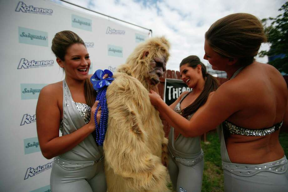 The Kokanee Sasquatch 2012 girls hang out with a sasquatch. Photo: SOFIA JARAMILLO / SEATTPI.COM