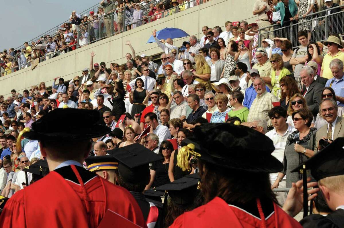 The graduate processional makes it's way past family and friends during Rensselaer Polytechnic Institute's 206th Commencement in Troy N.Y. Saturday May 26, 2012. (Michael P. Farrell/Times Union)
