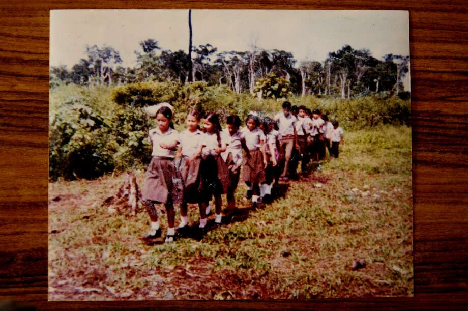 "Victims of Dos Erres are shown here in a family photo, marching as part of a show of ""civic support"" to the Guatemalan military. Photo: Arturo Godoy"