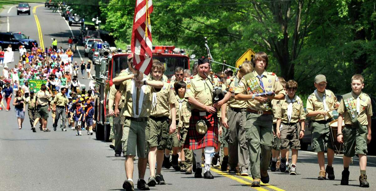 Boy Scouts Troop 15 color guard leads the Redding Memorial Day Parade Saturday, May 26, 2012.