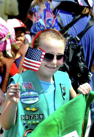 Logan Samuels, 10, marches with the Girl Scouts in the Redding Memorial Day Parade Saturday, May 26, 2012. Photo: Michael Duffy / The News-Times