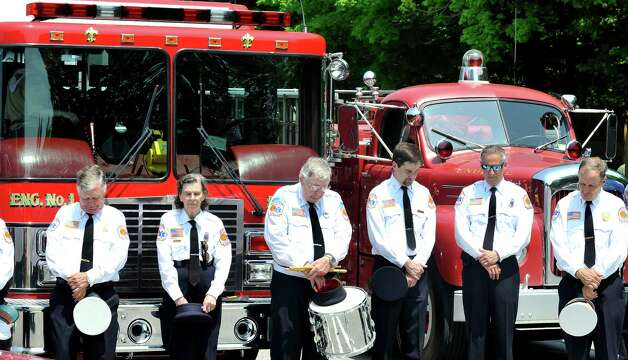 Members of the Redding Fire Department EMS pause during the invocation at the start of the Redding Memorial Day Parade Saturday, May 26, 2012. Photo: Michael Duffy / The News-Times