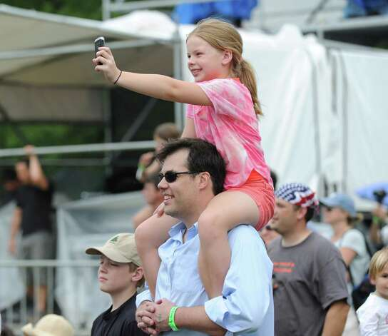 Grant Gregory of Greenwich and his daughter, Kathryn, 9, enjoy the peformance of Dave Matthews during the Greenwich Town Party at Roger Sherman Baldwin Park, Saturday, May 26, 2012. Photo: Bob Luckey / Greenwich Time