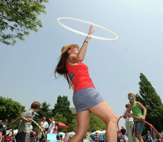 Mary-Beth Oliver of Milford displays her hoop skills during the Greenwich Town Party at Roger Sherman Baldwin Park, Saturday, May 26, 2012. Photo: Bob Luckey / Greenwich Time