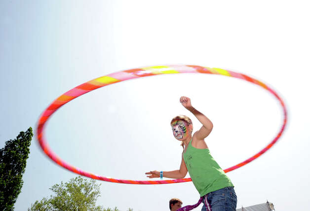 Elena Higgins, 6, of Greenwich, displays her hoop skills during the Greenwich Town Party at Roger Sherman Baldwin Park, Saturday, May 26, 2012. Photo: Bob Luckey / Greenwich Time