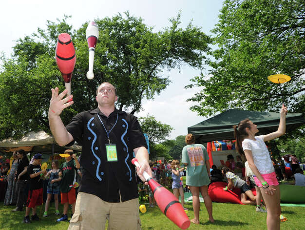 Juggler Mark Conigliaro entertains during the Greenwich Town Party at Roger Sherman Baldwin Park, Saturday, May 26, 2012. Photo: Bob Luckey / Greenwich Time