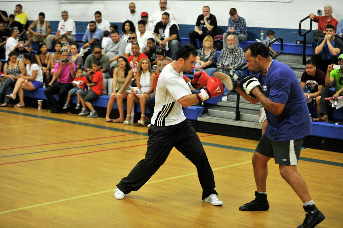 Delvin Rodriguez, left, demonstrates a training session with his trainer Fernely Feliz in front of a crowd gathered for Rodriguez's World Championship Send-Off event at the Danbury War Memorial on Saturday, May 26, 2012. Rodriguez will be competing for the World Boxing Association junior middleweight world championship on June 2.