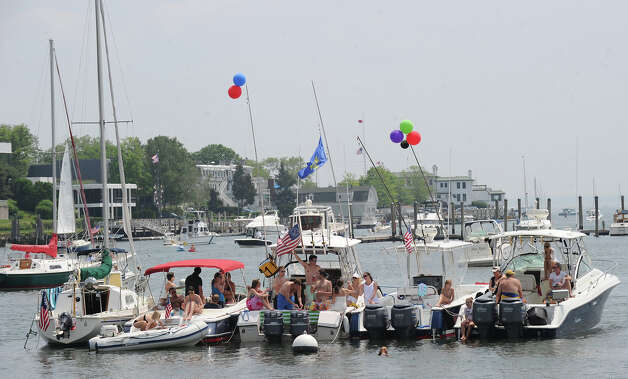 Boats moored in Greenwich harbor enjoy the Greenwich Town Party at Roger Sherman Baldwin Park, Saturday, May 26, 2012. Photo: Bob Luckey / Greenwich Time