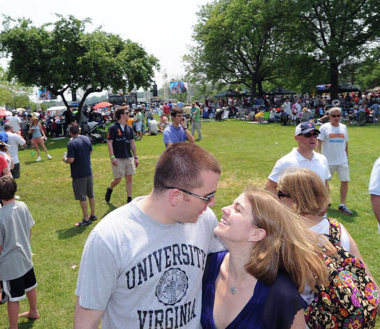 Vinny DiResta kisses his fiancee Katharine Wesley of Greenwich during the Greenwich Town Party at Roger Sherman Baldwin Park, Saturday, May 26, 2012. The couple plan to marry this Thanksgiving. Photo: Bob Luckey / Greenwich Time