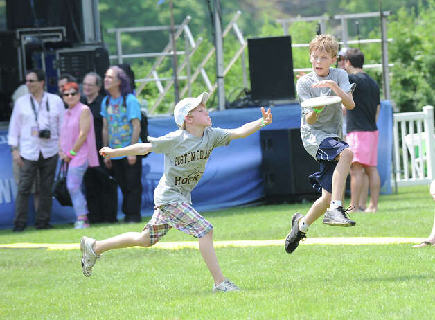 At left, Jack Eschricht, 10, of Greenwich, defends as his friend, Jackson Rubich, 12, also of Greenwich, makes a catch during a game of flying disc at the Greenwich Town Party at Roger Sherman Baldwin Park, Saturday, May 26, 2012. Photo: Bob Luckey / Greenwich Time