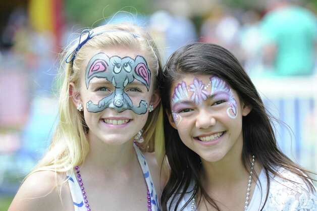 Face-painted friends, Kara Bittman, left, 12, and Alissa Landberg, also 12, both of Greenwich, during the Greenwich Town Party at Roger Sherman Baldwin Park, Saturday, May 26, 2012. Photo: Bob Luckey / Greenwich Time