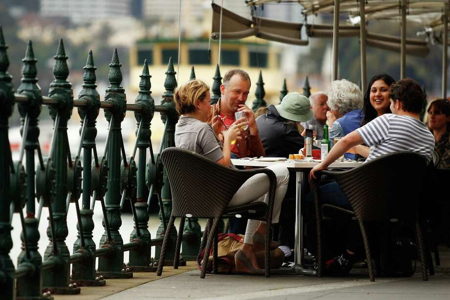 Customers dine outdoors at a restaurant in the Circular Quay area of Sydney. Australia was the only major developed nation to avoid a recession in 2009. Photo: Brendon Thorne / © 2012 Bloomberg Finance LP