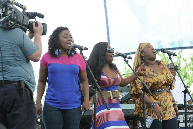 The Kirk Franklin Band backup singers during the Greenwich Town Party at Roger Sherman Baldwin Park, Saturday, May 26, 2012. Photo: Bob Luckey / Greenwich Time