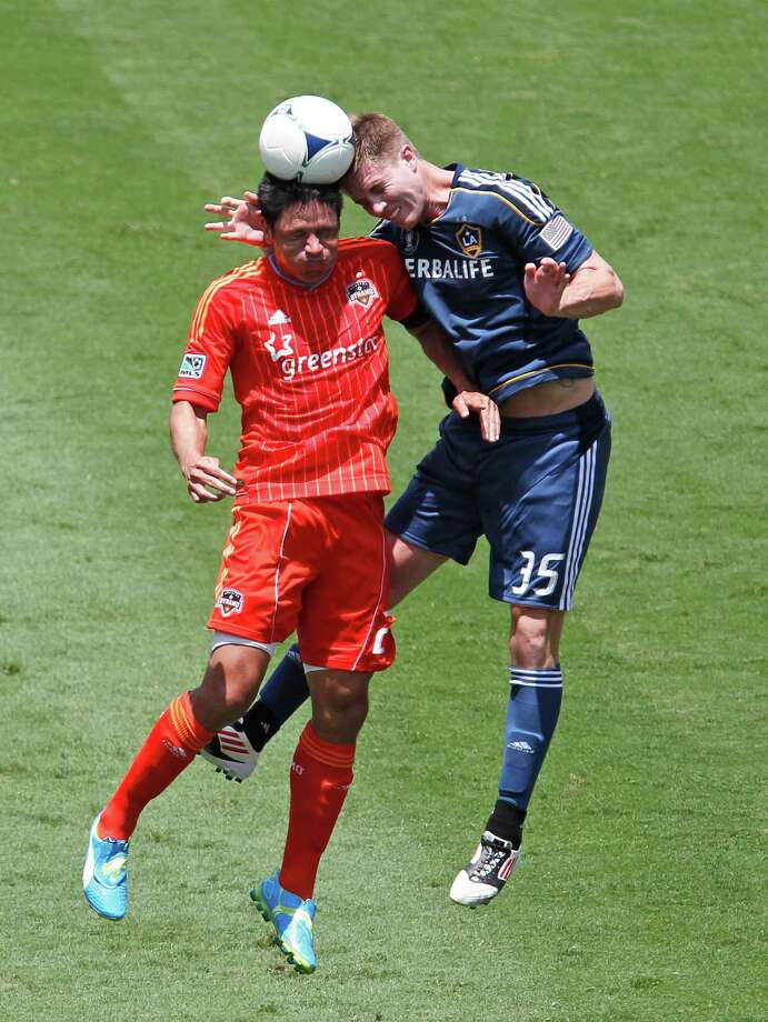 The Houston Dynamo's Brian Ching left and the Los Angeles Galaxy' Bryan Gaul during the first half of MLS game action at BBVA Compass Stadium Saturday, May 26, 2012, in Houston. Photo: James Nielsen, Chronicle / © Houston Chronicle 2012
