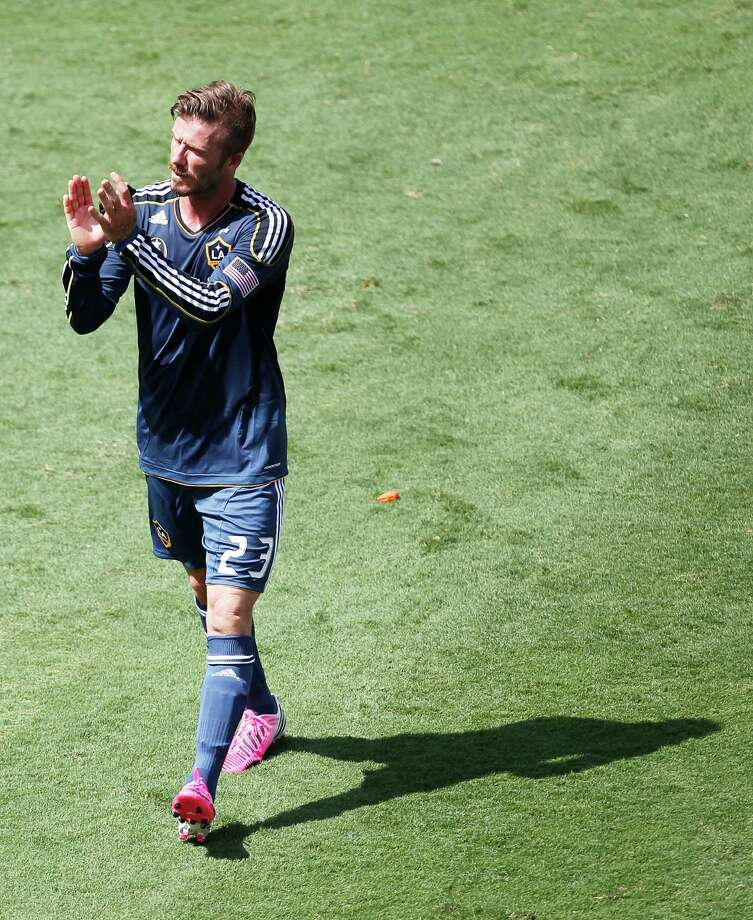 The Los Angeles Galaxy' midfielder David Beckham claps his hands after while leaving the field after the Houston Dynamo defeated the Galaxy 2-1 at BBVA Compass Stadium Saturday, May 26, 2012, in Houston. Photo: James Nielsen, Chronicle / © Houston Chronicle 2012