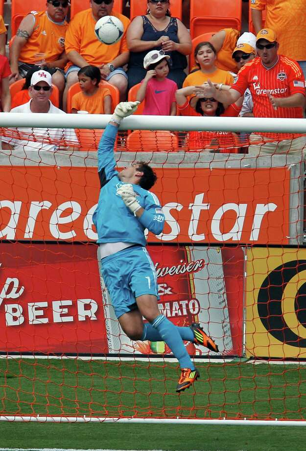 The Houston Dynamo goalkeeper Tally Hall blocks a shot by the Los Angeles Galaxy during the second half of MLS game action at BBVA Compass Stadium Saturday, May 26, 2012, in Houston. Photo: James Nielsen, Chronicle / © Houston Chronicle 2012